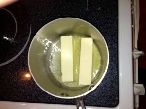 Melt 2 sticks of butter in a sauce pan over medium heat